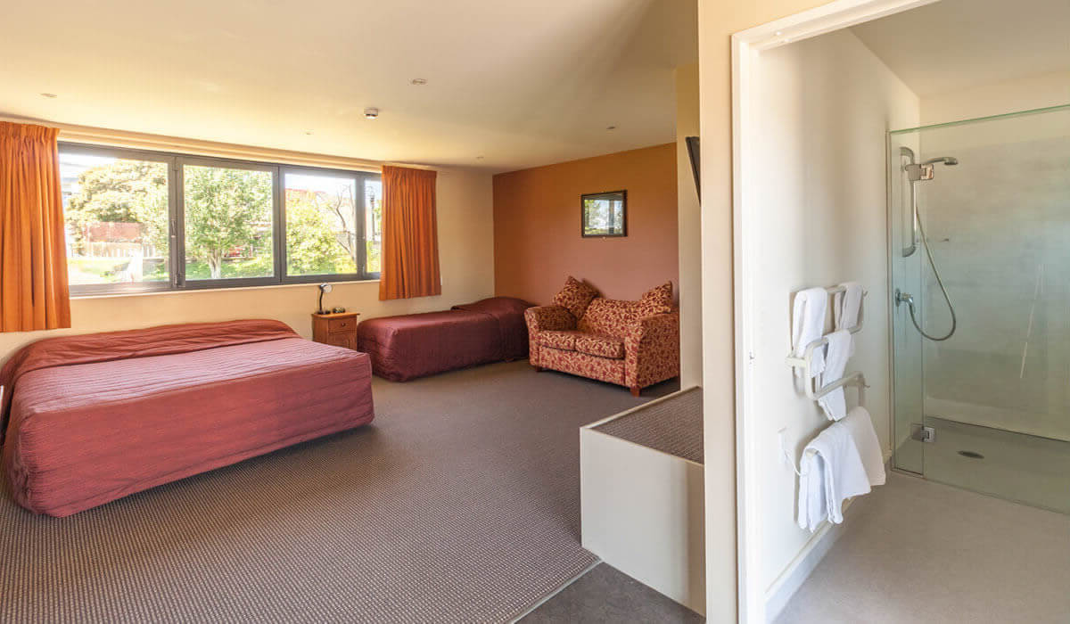 Bathroom And Living Area In Accessible Studio At Waterfront Motels In Blenheim